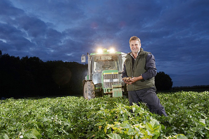 commercial Photographer, Potato harvest, tractor in field, night, farming